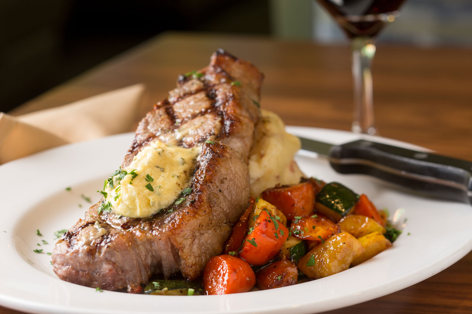 steak with mash potatoes and vegetables